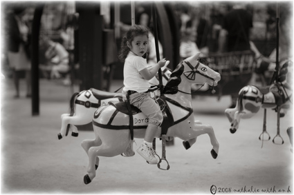 Little girl on wood horse